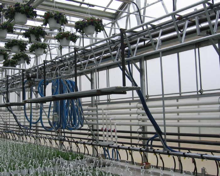 Nexus Greenhouse Systems :: Hot Water Radiant Heat on heating systems for greenhouse, solar for greenhouse, radiant heating tubing with soil, heaters for greenhouse, foundation for greenhouse, geothermal for greenhouse, wood heat for greenhouse, ceiling fan for greenhouse, windows for greenhouse, light for greenhouse, wood stove for greenhouse,